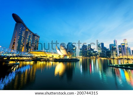 SINGAPORE - APRIL 7: View of Marina Bay on April 7, 2011 in Singapore. Night Scene. Marina Bay is famous destination in Singapore. - stock photo
