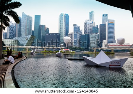 SINGAPORE - APRIL 15: View of skyscrapers in Marina Bay on April 15, 2012 on Singapore. Asian financial center, the city state is one of the most dynamically developing countries in the world. - stock photo