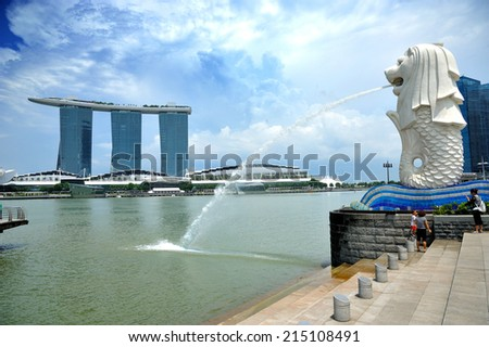 SINGAPORE - AUG 30: Dayview of The Merlion fountain & Marina Bay Sands hotel on Aug 30, 2014 in Singapore. Merlion is a imaginary creature with the head of a lion, seen as a symbol of Singapore. - stock photo