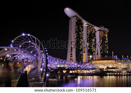 SINGAPORE- AUG 5:The Marina Bay Sands Resort Hotel & Helix Bridge(3.5km) on Aug 5, 2012 in Singapore. It is an integrated resort & the worlds most expensive standalone casino property at S$8 billion. - stock photo
