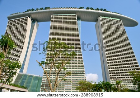 SINGAPORE- AUG 18: The Marina Bay Sands Resort Hotel on August 18, 2012 in Singapore. It is an integrated resort and the world's most expensive standalone casino property at S$8 billion. - stock photo