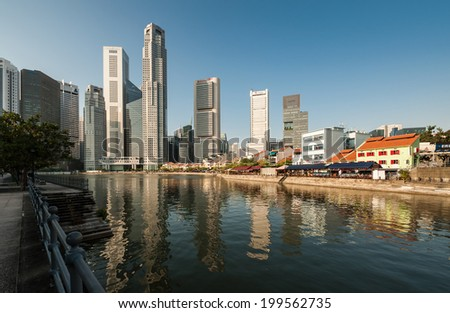 SINGAPORE-AUGUST 10: Business district and Boat Quay on August 10, 2012 in Singapore. Central Business District (CBD), located at south of Singapore River.  - stock photo