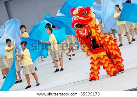 SINGAPORE - AUGUST 09: Lion dance performance during Singapore National Day Parade 2009 August 09, 2009 in Singapore - stock photo