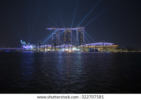 SINGAPORE - AUGUST 29: Night at Marina Bay Sands featuring the event of iLight Marina Bay on August 29, 2015 in Singapore. Lights are projected in the Singapore Art museum to show celebration of life. - stock photo