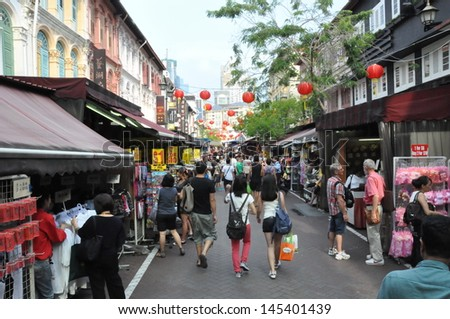 SINGAPORE - AUGUST 15: Singapore's Chinatown, an ethnic neighborhood featuring Chinese cultural elements and a historically concentrated ethnic Chinese population, as seen on August 15, 2012. - stock photo