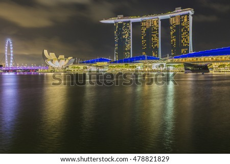 Singapore August 29th, 2016 - Marina Bay Sands laser light show, view from waterfront promenade.
