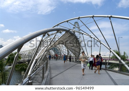SINGAPORE - AUGUST 21: The Helix Bridge on August 21, 2011 in Singapore, is a pedestrian bridge linking Marina Centre with Marina South in the Marina Bay area in Singapore. - stock photo