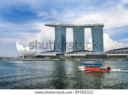 SINGAPORE - AUGUST 21:The Marina Bay Sands Resort August 21, 2011 in Singapore. The roofs of towers  are decorated with a entertainment park in the form of a ship 340 m long and capacity up to 3,900 people. - stock photo