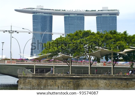 SINGAPORE-AUGUST 21:The Marina Bay Sands Resort August 21, 2011 in Singapore. The roofs of towers are decorated with a park in the form of a ship 340 m long and capacity up to 3,900 people. - stock photo