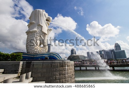 SINGAPORE-AUGUST 31: The Merlion beside Marina bay in Singapore view on August 31,2016. Merlion is a imaginary creature with the head of a lion,seen as a symbol of Singapore