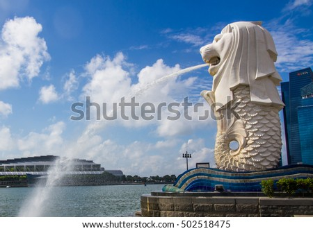 SINGAPORE-AUGUST 31: The Merlion beside Marina bay in Singapore view on August 31,2016. Merlion is a imaginary creature with the head of a lion,seen as a symbol of Singapore S