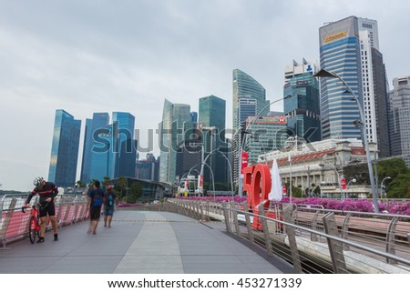 SINGAPORE - 08 August 2015: This Bridge for Tourists strolling the newly constructed Jubilee Bridge, built for pedestrians alongside the older Esplanade Theatre Bridge in Singapore. - stock photo