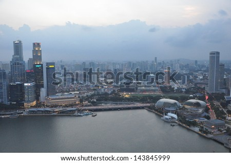 SINGAPORE - AUGUST 15: View of the Singapore skyline as seen on August 15, 2012.from Marina Bay Sands. The skyline comprises of more than 60 skyscrapers that rise higher than 140 metres (459 ft). - stock photo