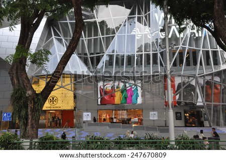 SINGAPORE - AUGUST 16: Wisma Atria on Orchard Road in Singapore, as seen on August 16, 2012. It is an established shopping mall on Orchard road with retail businesses on 5 levels. - stock photo