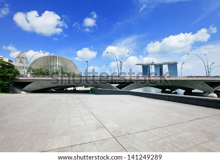 Singapore business district with empty square - stock photo