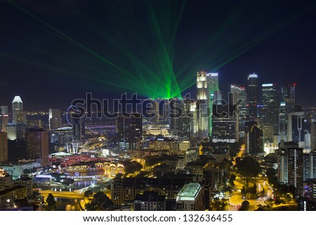 Singapore Central Business District Skyline and Laser Light Show at Blue Hour Evening - stock photo