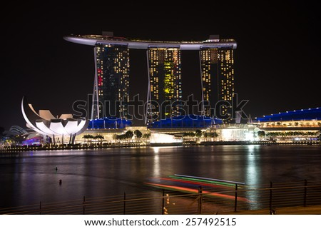 SINGAPORE - CIRCA JANUARY 2015 : Marina Bay Sands hotel and Lotus Architecture highlighted at night in Singapore - stock photo