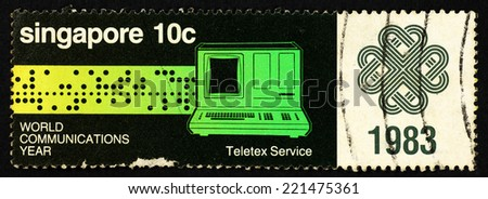 SINGAPORE - CIRCA 1983: Postage stamp printed in Singapore with image of a telex service machine to commemorate world communications year. - stock photo
