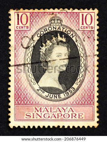 SINGAPORE - CIRCA 1953: Purple color postage stamp printed in Malaya Singapore with portrait image of Queen Elizabeth II to commemorate her coronation on 2nd June 1953. - stock photo