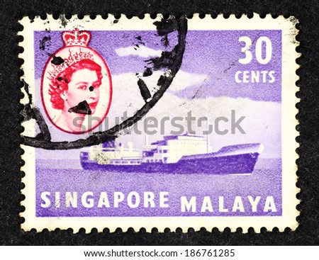 SINGAPORE - CIRCA 1961: Purple color postage stamp printed in Singapore with image of a cargo ship.  - stock photo