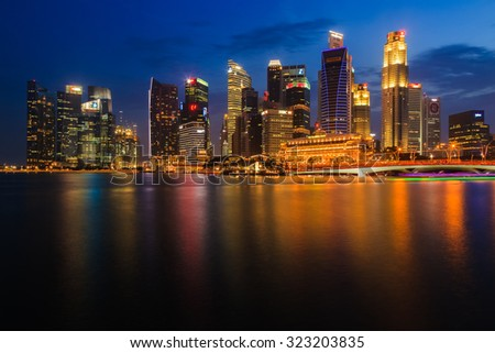 SINGAPORE CITY, SINGAPORE - AUGUST 15, 2015: Cityscape of financial district during twilight on August 15, 2015 at Marina Bay, Singapore.