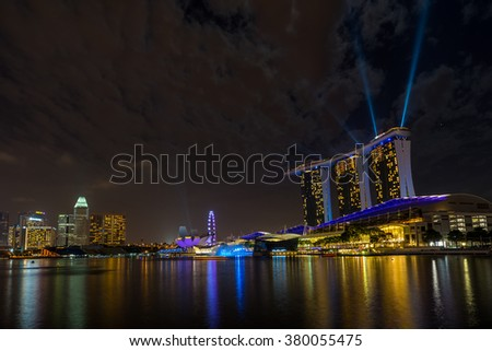 SINGAPORE CITY, SINGAPORE - FEBRUARY 21, 2016:  Marina Bay Sands at night during Light and Water Show 'Wonder Full' . It opened on 27 April 2010. Singapore on FEBRUARY 21, 2016