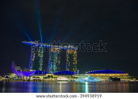 SINGAPORE CITY, SINGAPORE - FEBRUARY 22, 2016: Marina Bay Sands at night during Light and Water Show 'Wonder Full' . It opened on 27 April 2010. Singapore on FEBRUARY 22, 2016 - stock photo