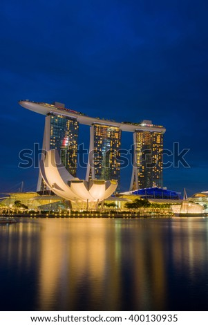 SINGAPORE CITY, SINGAPORE - FEBRUARY 22, 2016: Marina Bay Sands at night the largest hotel in Asia. It opened on 27 April 2010. Singapore on FEBRUARY 22, 2016 - stock photo