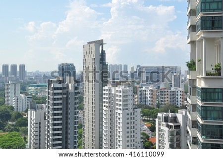 Singapore City, Singapore - June 10, 2014: High rise residential and commercial buildings are sprouting in this tiny but modern city like Singapore. - stock photo