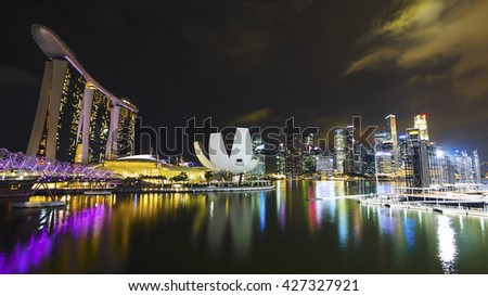 Singapore City, Singapore - May 30: View of Singapore City skyline with famous Marina Bay Sands hotel and Financial District at night. - stock photo