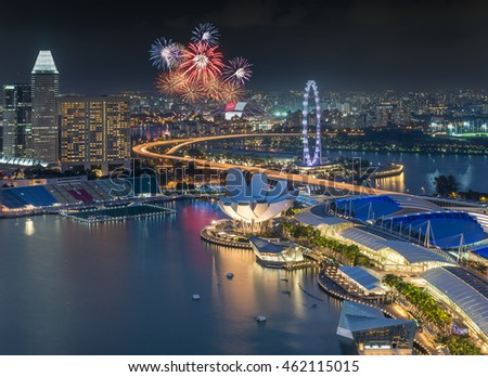 Singapore city skyline aeria viewl with firework during twilight time in Singapore National day