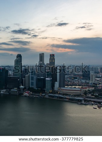Singapore City Skyline Aerial View Cityscape Aerial View Panorama of CBD over Marina Bay under Dramatic Twilight Sky Sunset in Summer Dusk