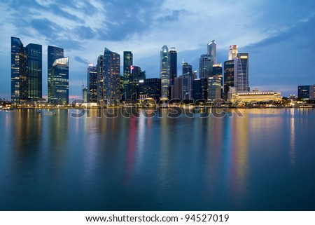Singapore City Skyline along Waterfront Esplanade at Blue Hour