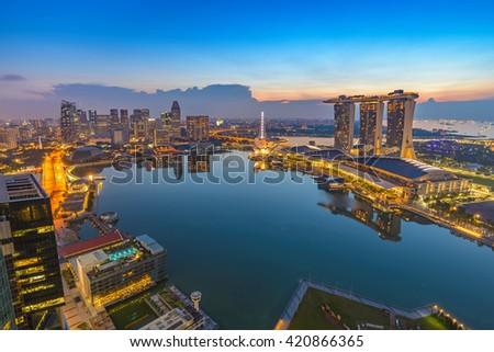 Singapore city skyline at Marina Bay when sunrise  - stock photo