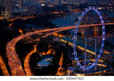 Singapore city skyline at night time. - stock photo