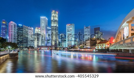 Singapore city skyline view from Singapore river with boat light movement during twilight - stock photo
