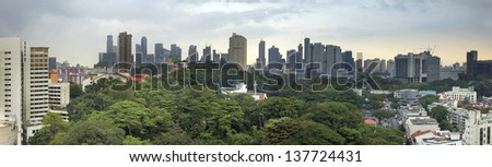 Singapore City Skyline with Lush Green Landscape Panorama - stock photo