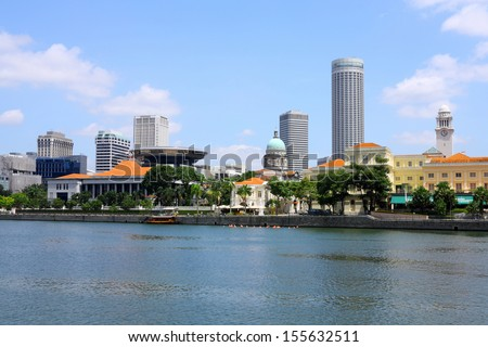 Singapore City skyline with older colonial buildings in foreground and modern skyscrapers in background. Modern Asia. - stock photo