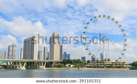 Singapore cityscape againt cloud and blue sky - stock photo