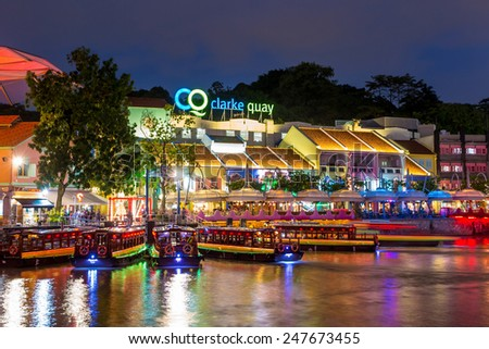 SINGAPORE-DEC 16: Colorful light building at night in Clarke Quay, Singapore on December 16, 2014. Clarke Quay, is a historical riverside quay in Singapore, located within the Singapore River Area. - stock photo