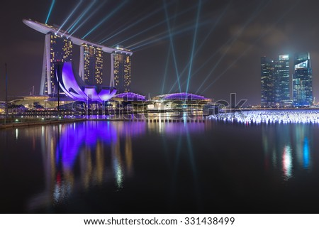 SINGAPORE - 30 DEC 2013: Marina Bay Sands, spectacular end futuristic lighting display on the water front ?nd floating balls, with beautiful reflections on the water. - stock photo