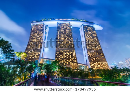 SINGAPORE - DEC 31: Night view at Marina Bay Sands Resort Hotel in Singapore on Dec 31, 2013. Luxury hotel and most expensive in world standalone casino property is main tourist attraction at city - stock photo
