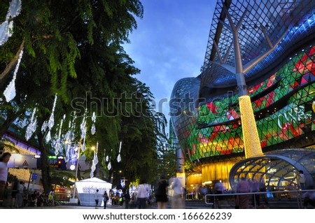 SINGAPORE - DEC 9: Night view of Christmas Decoration at Singapore Orchard Road on December 9, 2013 in Singapore. The street with twinkling stars, sparking diamonds and dressed-up shopping centres.  - stock photo