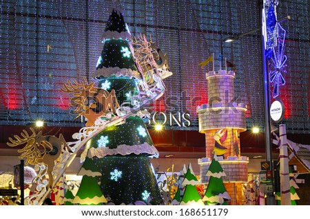 SINGAPORE - DEC 22: Night view of Christmas Decoration at Singapore Orchard Road on December 22, 2013 in Singapore. The street with twinkling stars, sparking diamonds and dressed-up shopping centres.  - stock photo
