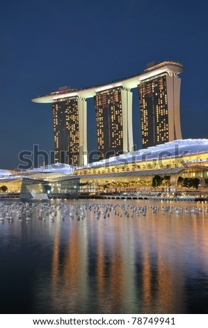 SINGAPORE - DEC 31: Night view of the Marina Bay Sands resort hotels on Dec 31, 2010 in Singapore. Developed by Las Vegas Sands, it is billed as the world's most expensive casino. - stock photo