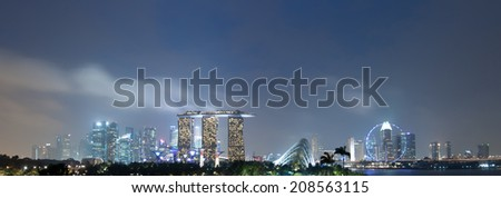 SINGAPORE - 31 DEC, 2013: Panoramic view of Singapore city skyline at late sunset. Marina Bay Sands downtown district is extremely popular travel destination in Asia - stock photo