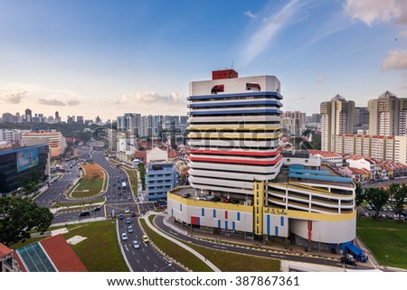 Singapore, 30 Dec 2015: Sim Lim Tower and surrounding buildings during sunset. It is known as a big electronics mall and for its variety of electronic components. - stock photo