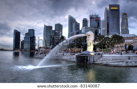 SINGAPORE-DEC 29: The Merlion fountain and Singapore skyline on Dec. 29, 2010. Merlion is an imaginary creature with a head of a lion and the body of a fish and is often seen as a symbol of Singapore. - stock photo