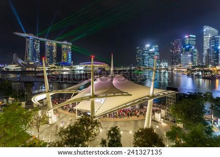 SINGAPORE -Dec 26: Wonderful sunrise at the Marina Bay waterfront in Singapore. Marina Bay Sands Hotel dominates the skyline at Marina Bay on Dec 26 , 2014 - stock photo