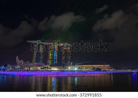 Singapore-December 26,2015:Beautiful laser show at the marina bay waterfrontin Southeast Asia on December 26,2015,Singapore - stock photo
